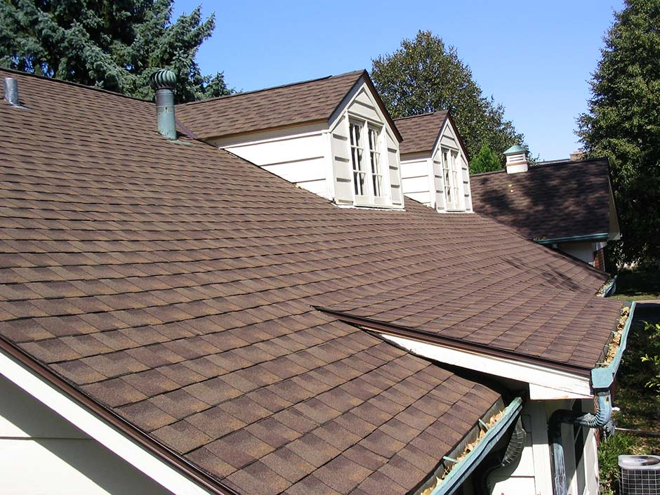 A new roof on a house with brown shingles.