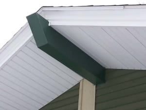 A close up of a new support beam on a roof overhang.