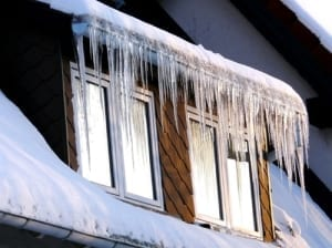 Icicles hanging from the gutter of a house.