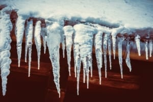 Icicles hanging from a roof gutter.